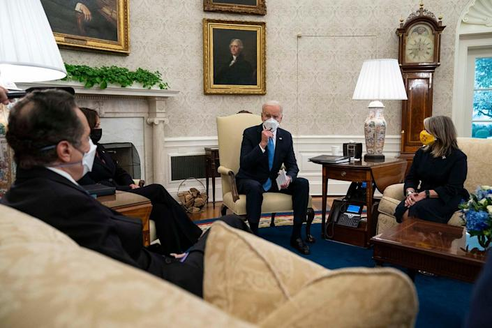 President Joe Biden speaks during a meeting with a bipartisan group of mayors and governors to discuss a coronavirus relief package, in the Oval Office of the White House, Friday, Feb. 12, 2021, in Washington. From left, Gov. Andrew Cuomo, D-N.Y., Vice President Kamala Harris, Biden, and Gov. Michelle Lujan Grisham, D-N.M. (AP Photo/Evan Vucci) ORG XMIT: DCEV109