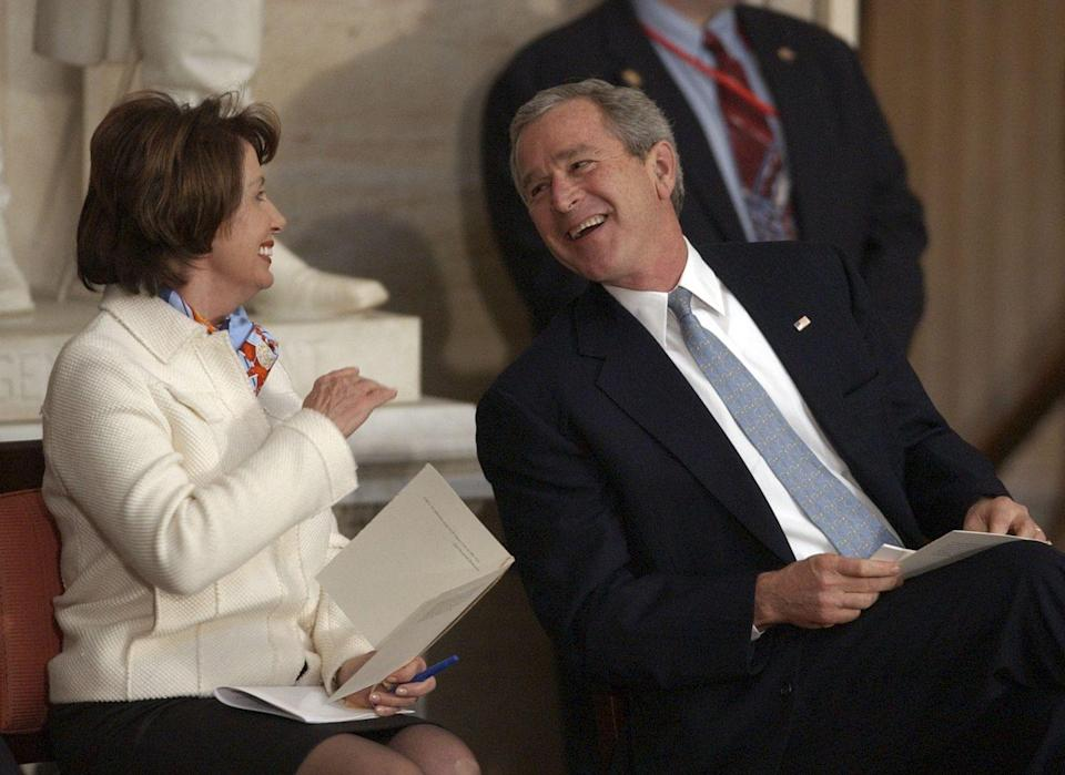 <p>George W. Bush and Pelosi share a laugh while attending the Congressional Gold Medal ceremony.</p>
