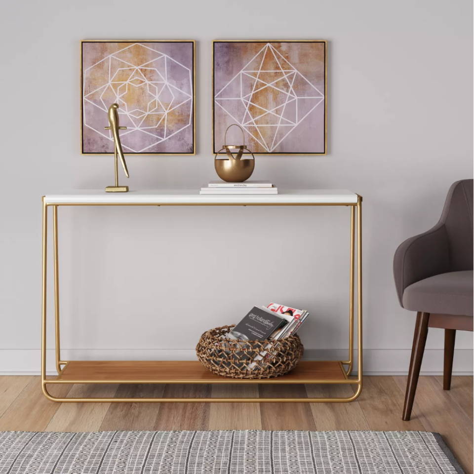 """<h3><a href=""""https://www.target.com/p/sayer-console-table-white-project-62-153/-/A-52377481"""" rel=""""nofollow noopener"""" target=""""_blank"""" data-ylk=""""slk:Project 62 Sayer Console Table"""" class=""""link rapid-noclick-resp"""">Project 62 Sayer Console Table</a></h3><p>A long console table with an unencumbered frame can work wonders as a room separator with bonus storage benefits.</p><br><br><strong>Project 62</strong> Sayer Console Table White, $139.99, available at <a href=""""https://www.target.com/p/sayer-console-table-white-project-62-153/-/A-52377481"""" rel=""""nofollow noopener"""" target=""""_blank"""" data-ylk=""""slk:Target"""" class=""""link rapid-noclick-resp"""">Target</a>"""