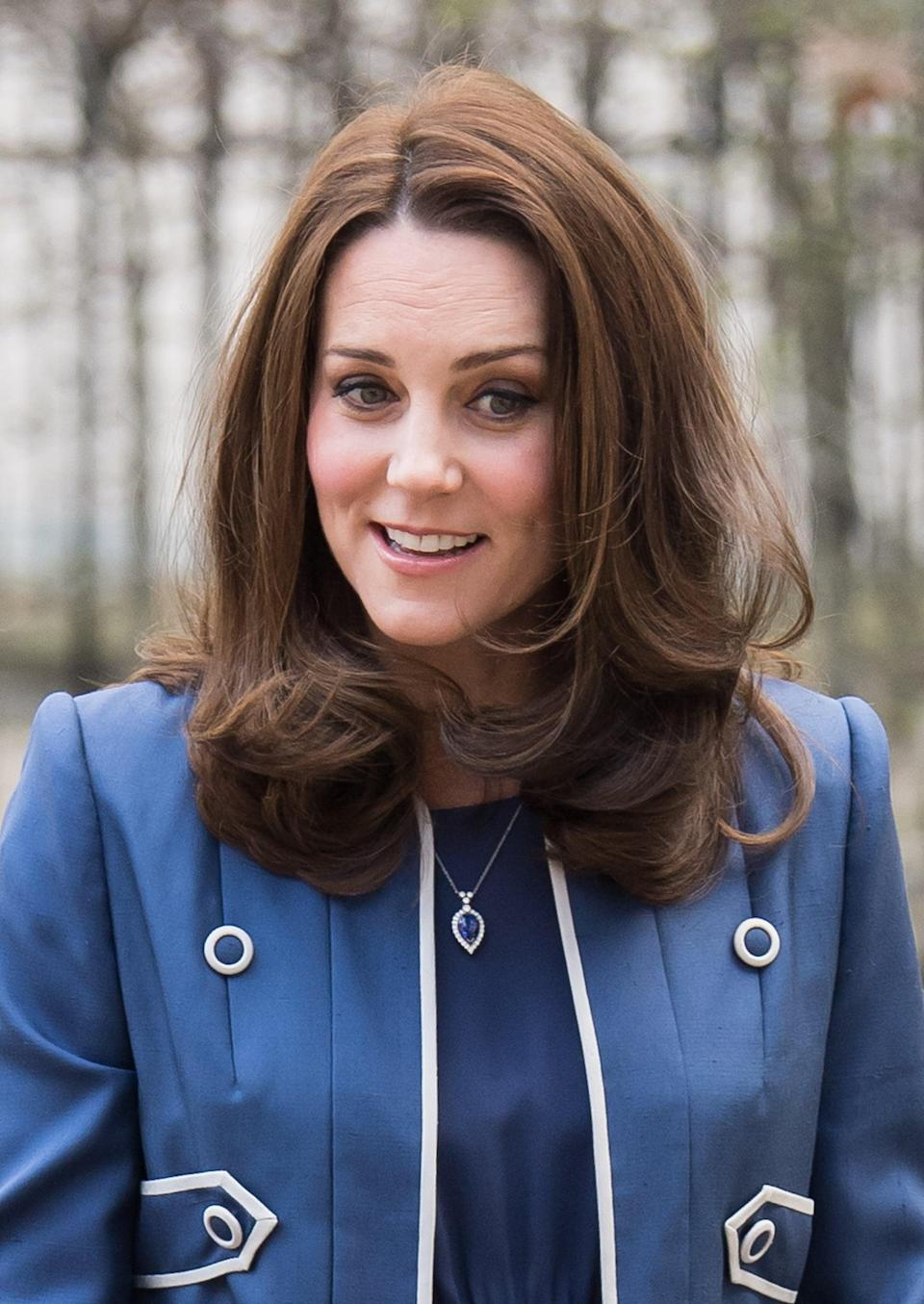 <p>It's her bouncy blowout but rumpled and tousled for a much more casual vibe than we're used to seeing from the duchess. With a clean side part, it makes for the perfect day-time look for royal outings. </p> <p>The duchess's shoulder-length layers styled in a side parting were the perfect day-time look for royal outings. </p>