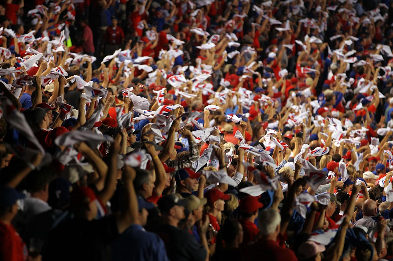 ARLINGTON, TX - OCTOBER 24: Fans wave rally towels during Game Five of the MLB World Series between the St. Louis Cardinals and the Texas Rangers at Rangers Ballpark in Arlington on October 24, 2011 in Arlington, Texas.  (Photo by Ezra Shaw/Getty Images)