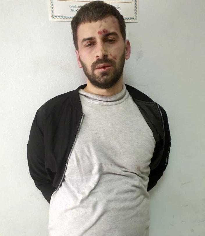"""This Monday, April 19, 2021 photo provided by the Albanian Police shows Rudolf Nikolli, 34, after his arrest in Tirana, Albania. The Albanian young man has attacked with a knife and injured five persons at a mosque in the capital Tirana, according to police. A statement on Monday said that at about 2.30 p.m. (1230 GMT) Rudolf Nikolli, 34, entered the Dine Hoxha mosque downtown Tirana and """"in unclear situation he injured with a knife 5 citizens."""" Police forces reacted immediately and managed to """"neutralize him"""" but have yet to disclose the cause of the attack. (Albanian Police via AP)"""