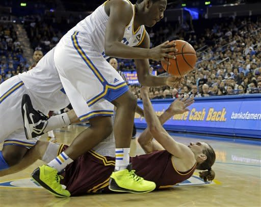 UCLA guard Jordan Adams (3) collides with Arizona State center Jorday Bachynski (13) in the first half of an NCAA college basketball game in Los Angeles Wednesday, Feb. 27, 2013. (AP Photo/Reed Saxon)