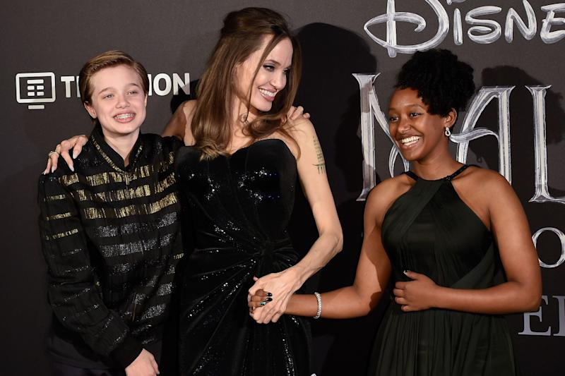 Angelina Jolie and her children Shiloh Jolie-Pitt (left) and Zahara Jolie-Pitt at a premiere in 2019.  (Photo: Mondadori Portfolio via Getty Images)