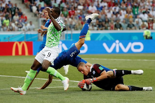 Soccer Football - World Cup - Group D - Nigeria vs Iceland - Volgograd Arena, Volgograd, Russia - June 22, 2018 Iceland's Hannes Halldorsson and Sverrir Ingi Ingason in action with Nigeria's Odion Ighalo REUTERS/Toru Hanai