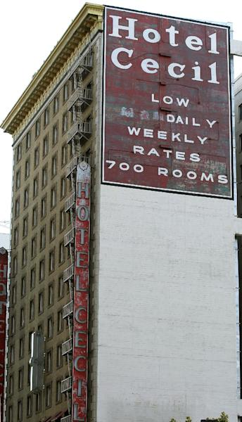 FILE - Hotel Cecil in Los Angeles is seen in a Wednesday Feb. 20, 2013 file photo. Police say the body of a missing Canadian woman was found Tuesday at the bottom of one of four cisterns on the roof of the hotel. The tanks provide water for hotel taps and would have been used by guests for washing and drinking. Los Angeles County Department of Public Health officials were expected to release the results of tests on the water on Thursday, Feb. 21. Investigators used body markings to identify 21-year-old Elisa Lam, police spokeswoman Officer Diana Figueroa said late Tuesday. (AP Photo/Nick Ut, File)