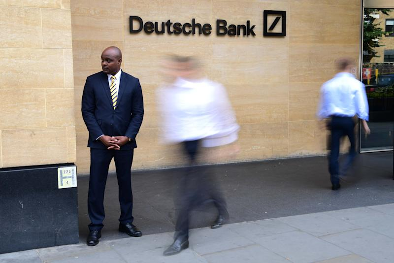 LONDON, ENGLAND - JULY 08: A security guard stands outside the Deutsche Bank building in central London as city workers walk past on July 8, 2019 in London, England. Deutsche Bank have started to make the first of a proposed 18,000 job cuts as part of a radical restructuring plan. (Photo by Leon Neal/Getty Images)