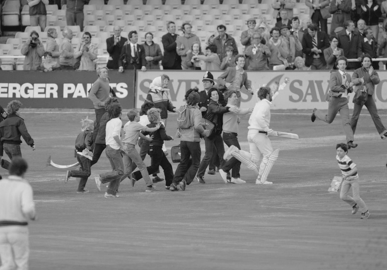Ian Botham is mobbed by young fans as he runs off at the end of the third Test at Headingley 1981. He had scored 149, not out. (Photo by Adrian Murrell/Getty Images)