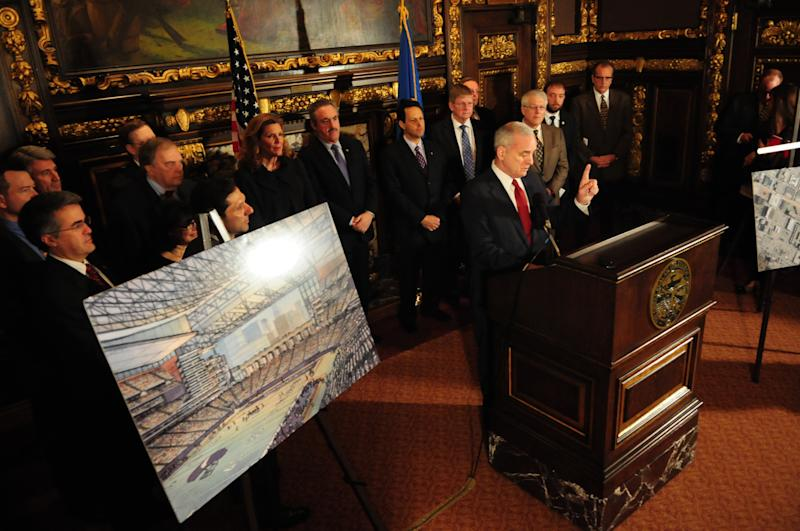 Minnesota Governor Mark Dayton, along with political leaders and the Minnesota Vikings, speaks during a news conference about a deal reached among legislative leaders for a new Vikings stadium, Thursday, March 1, 2012, at the state capitol in St. Paul, Minn. The plan would put the new building nearly on top of the current Metrodome site. (AP Photo/The St. Paul Pioneer Press,Ben Garvin ) MINNEAPOLIS STAR TRIBUNE OUT
