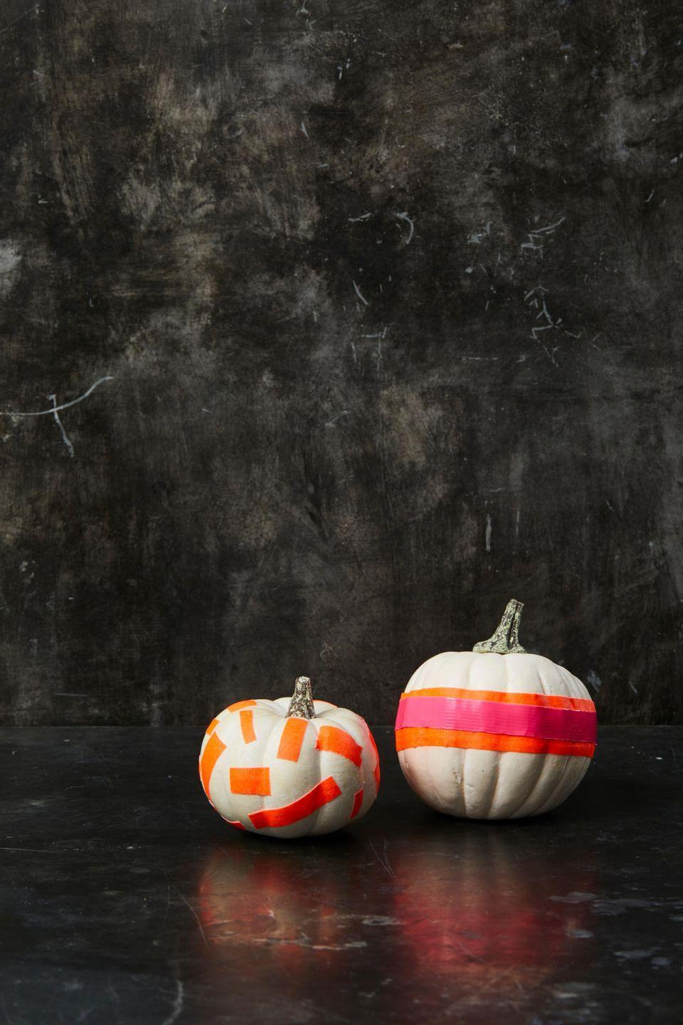 "<p>These pumpkins are instant attention-grabbers, and making them is a snap. Simply cut pieces of neon tape (including blacklight tape if you want!) and stick them onto a white or painted pumpkin. </p><p><a class=""link rapid-noclick-resp"" href=""https://www.amazon.com/5-Pack-BRIGHT-Blacklight-Reactive-Fluorescent/dp/B01CW3LH6I/ref=asc_df_B01CW3LH6I/?tag=syn-yahoo-20&ascsubtag=%5Bartid%7C10055.g.1714%5Bsrc%7Cyahoo-us"" rel=""nofollow noopener"" target=""_blank"" data-ylk=""slk:SHOP NEON TAPE"">SHOP NEON TAPE</a></p>"