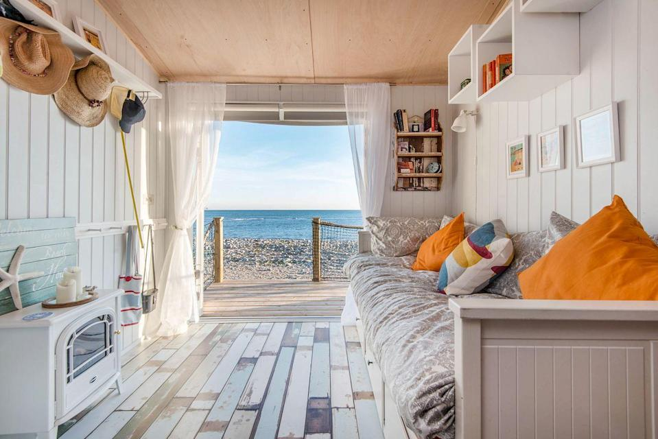 """<p>Seaside holiday stays don't get more heavenly than this adorable coastal abode with decking that is slap bang on Monmouth beach. </p><p>The chalet is brand new and features heating (for all climes), a kitchen, shower room and mezzanine level where the sleeping quarters are located. Grab a bottle of wine and dine al fresco one evening before waking up the next day to waves crashing against the shoreline.</p><p><strong>House for three people, price on request </strong></p><p><a class=""""link rapid-noclick-resp"""" href=""""https://go.redirectingat.com?id=127X1599956&url=https%3A%2F%2Fwww.toadhallcottages.co.uk%2Fholiday-cottages%2Fthe-little-sea-house%2F1865&sref=https%3A%2F%2Fwww.elle.com%2Fuk%2Flife-and-culture%2Fculture%2Fg33261665%2Fcoastal-cottages%2F"""" rel=""""nofollow noopener"""" target=""""_blank"""" data-ylk=""""slk:BOOK ONLINE"""">BOOK ONLINE</a></p>"""