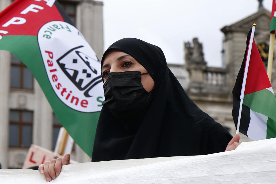 People hold Palestinian flags and banners during a demonstration in Lille, northern France, Saturday May 15, 2021. Marches in support of Palestinians in the Gaza Strip were being held Saturday in a dozen French cities, but the focus was on Paris, where riot police got ready as organizers said they would defy a ban on the protest. (AP Photo/Michel Spingler)