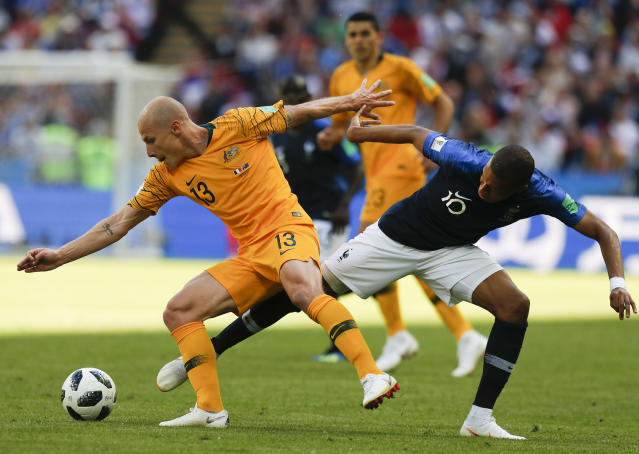 Australia's Aaron Mooy, left vies for the ball with France's Kylian Mbappe during the group C match between France and Australia at the 2018 soccer World Cup in the Kazan Arena in Kazan, Russia, Saturday, June 16, 2018. (AP Photo/Pavel Golovkin)
