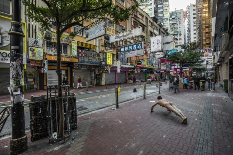 Ou Zhihang's photographs himself exercising nude at sites such as the Hong Kong bookstore linked to the disappearance of five booksellers