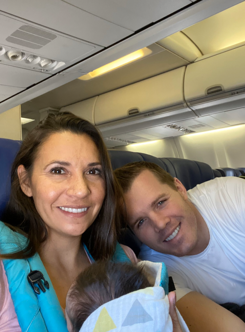 The Moores flying home with their baby girl. (Photo: Dustin Moore)