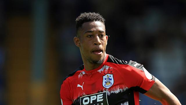 Tommy Smith, Jonathan Hogg and Rajiv van La Parra have all signed new three-year deals at Premier League newcomers Huddersfield Town.