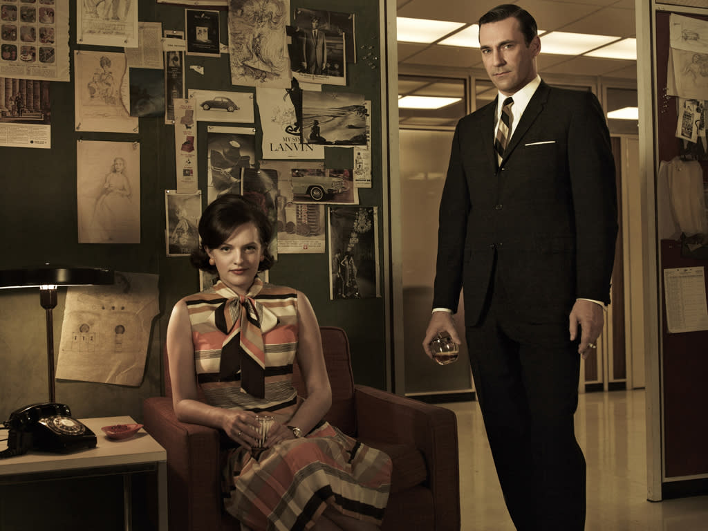 """Elisabeth Moss as Peggy Olson and Jon Hamm as Don Draper in """"<a target=""""_blank"""" href=""""http://tv.yahoo.com/mad-men/show/39828"""">Mad Men</a>."""""""