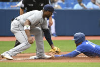 Toronto Blue Jays' George Springer, right, slides safely into third base ahead of a tag by Tampa Bay Rays Yandy Diaz following a wild pitch to Vladimir Gurrero Jr during the fifth inning of a baseball game Wednesday, Sept. 15, 2021 in Toronto. (Jon Blacker/The Canadian Press via AP)