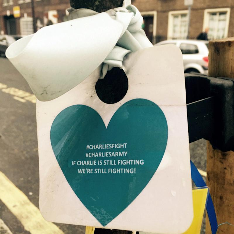 Ribbons and hearts tied to trees outside Great Ormond Street Hospital in London by well wishers backing a campaign to allow terminally ill baby Charlie Gard to be treated in America - Credit: PA