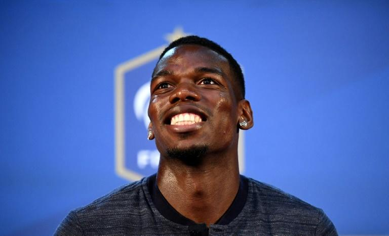 Ending with a smile: Paul Pogba wants to banish bad memories of Euro 2016 by winning the World Cup