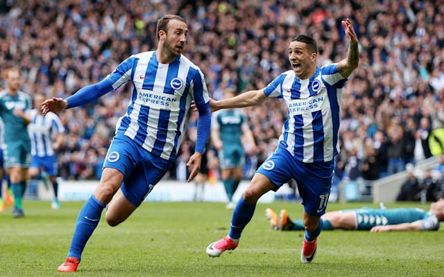 Brighton 2 Wigan 1: Pandemonium at the Amex as Glenn Murray and Solly March secure Premier League promotion