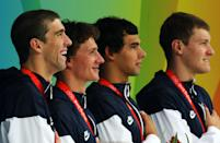 <b>Medal No. 13</b><br>From left to right, Michael Phelps, Ryan Lochte, Ricky Berens and Peter Vanderkaay pose with the gold medal on the podium during the medal ceremony for the Men's 4 x 200m Freestyle Relay Final in Beijing. The United States won the race in a time of 6:58.56, a new world record.