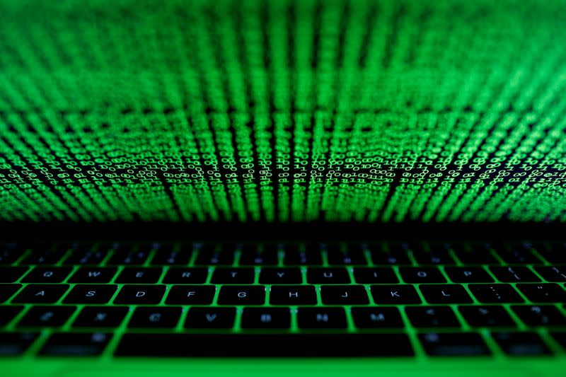 FILE PHOTO: A computer keyboard lit by a displayed cyber code is seen in this illustration picture