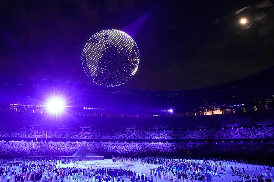 TOKYO, JAPAN - JULY 23: Drones fly to form an image of the Earth over the top of the stadium during the Opening Ceremony of the Tokyo 2020 Olympic Games at Olympic Stadium on July 23, 2021 in Tokyo, Japan. (Photo by Wei Zheng/CHINASPORTS/VCG via Getty Images)