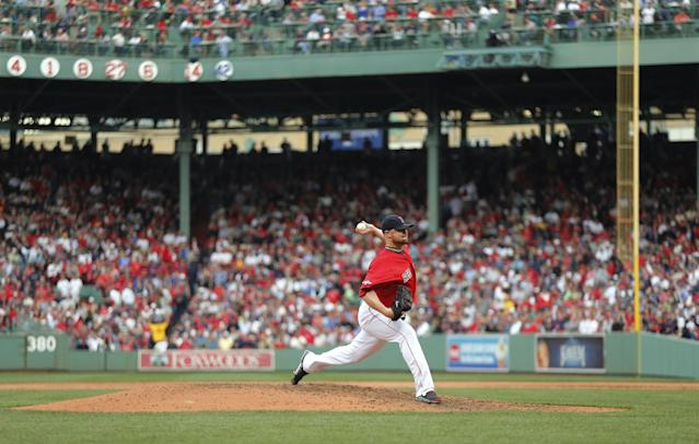Boston Red Sox starting pitcher Jon Lester delivers against the Tampa Bay Rays in the fifth inning in Game 1 of baseball's American League division series, Friday, Oct. 4, 2013, in Boston. (AP Photo/Michael Dwyer)