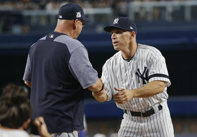 Joe Girardi greets Terry Francona before Game 3 of an American League Division Series baseball game, Sunday, Oct. 8, 2017, in New York. (AP Photo/Kathy Willens)