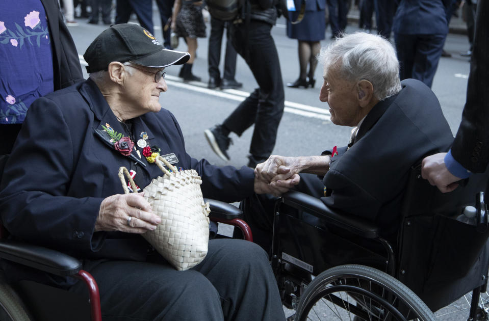Veterans chat ahead of the Anzac Day parade in Sydney, Australia, Sunday, April 25, 2021. Australians and New Zealanders paid tribute to their war dead Sunday as both nations prepared to withdraw from their longest war in Afghanistan. (AP Photo/Mark Baker)