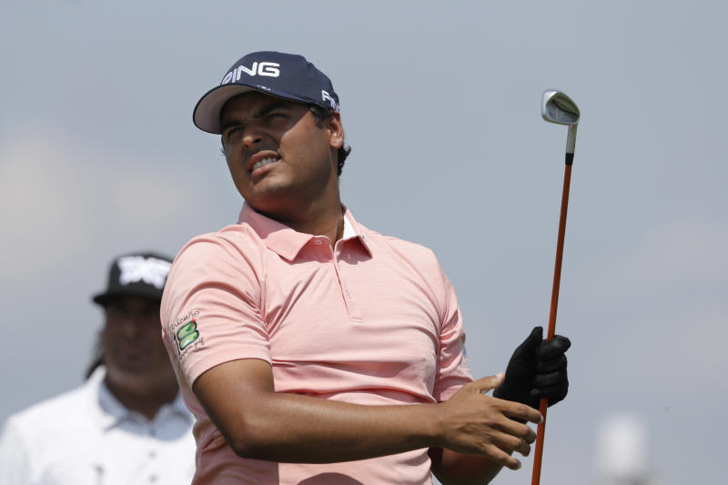 Sebastian Munoz, of Colombia, watches his shot at the first tee in the Northern Trust golf tournament at Liberty National Golf Course, Thursday, Aug. 8, 2019 in Jersey City, N.J. (AP Photo/Mark Lennihan)