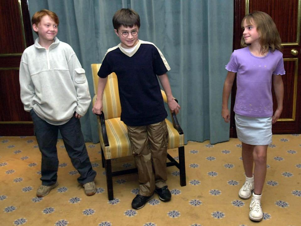 Daniel Radcliffe (center), Rupert Grint (left) and Emma Watson when they were cast as Harry, Ron, and Hermione.