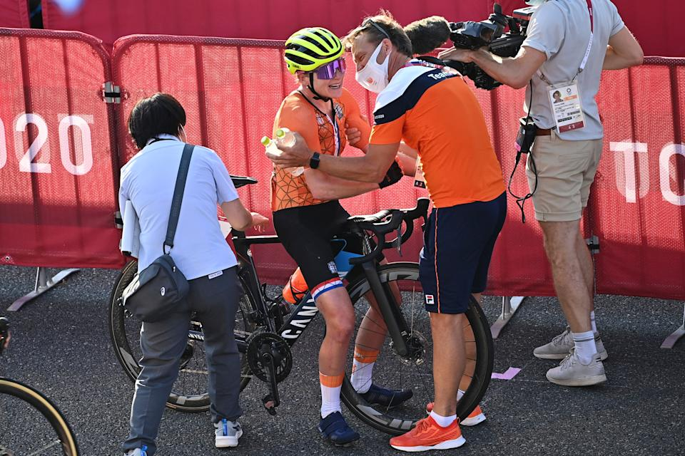 Netherlands' Annemiek Van Vleuten celebrates her second position with a member of Netherlands' cycling team in the women's cycling road race of the Tokyo 2020 Olympic Games at the Fuji International Speedway in Oyama, Japan, on July 25, 2021.  / AFP / Ben STANSALL