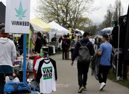 People walk among various vendor tents at the annual 4/20 marijuana event at Sunset Beach in Vancouver