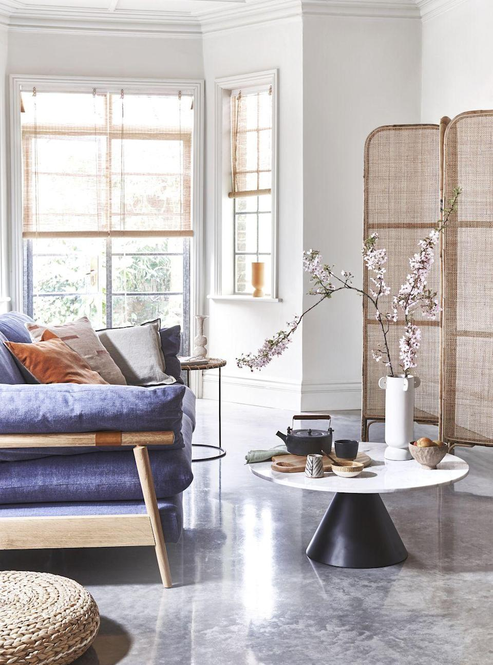 <p>On-trend materials like marble and polished concrete can feel quite cool, so balance them out with delicate, organic details such as bamboo blinds and rattan furniture.</p>