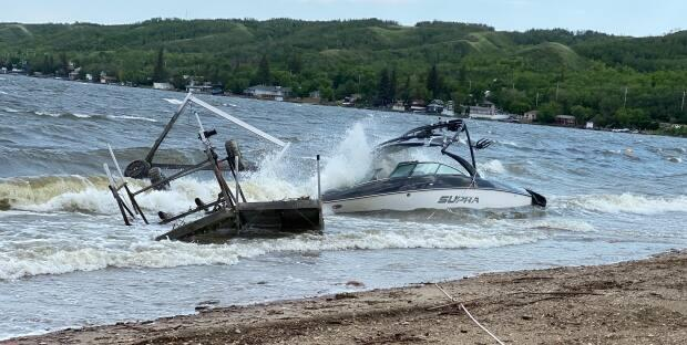 The Resort Village of B-Say-Tahsaid that high winds had caused significant wave action on Echo Lake, causing docks, Sea-Doos, boats and other items to scatter and smash into each other.