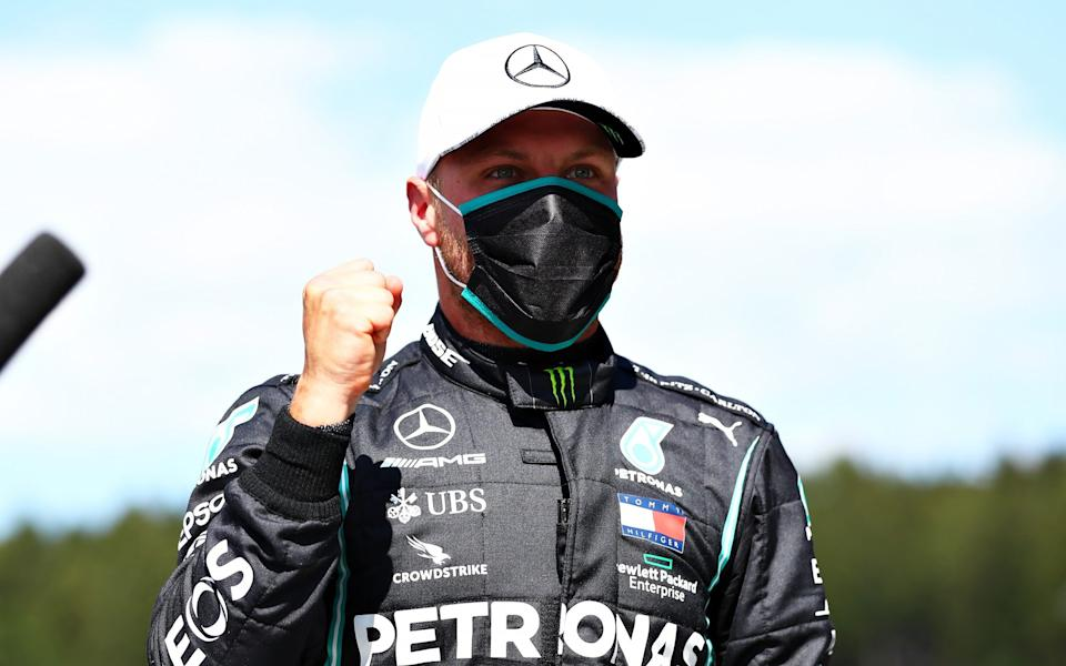 Pole position qualifier Valtteri Bottas of Finland and Mercedes GP celebrates in parc ferme during qualifying for the Formula One Grand Prix of Austria at Red Bull Ring on July 04, 2020 - Photo by Dan Istitene - Formula 1/Formula 1 via Getty Images