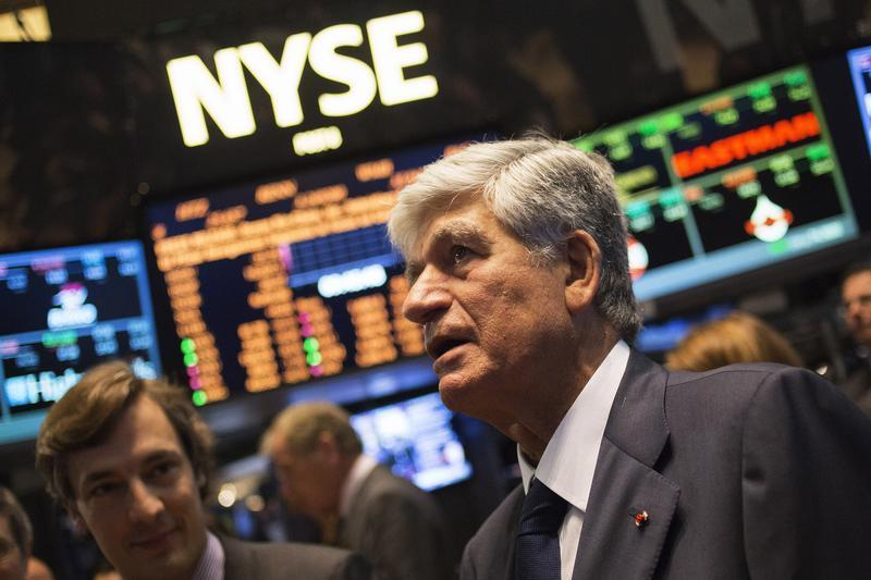 Publicis Group Chairman and CEO Maurice Levy watches a stock ticker after announcing an agreement on a merger on the floor of the New York Stock Exchange with Omnicom Chief Executive John Wren in New York