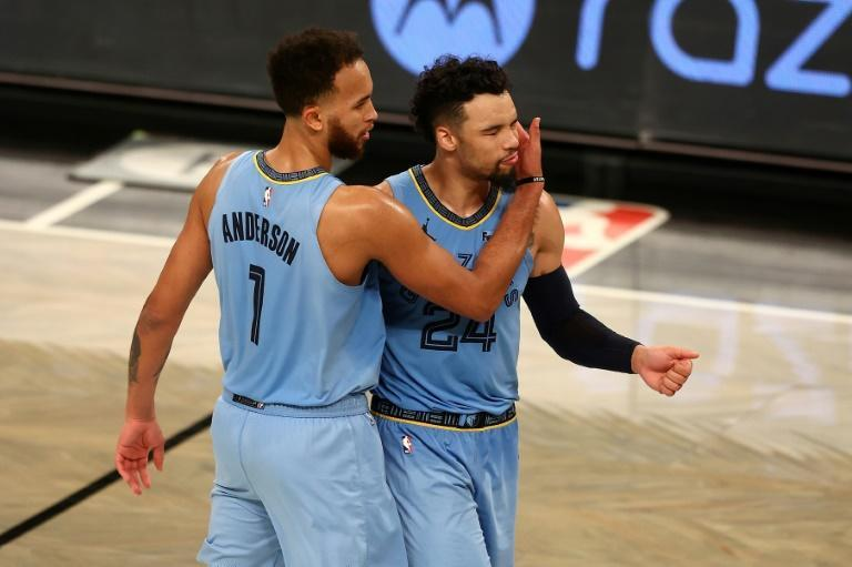 Kyle Anderson (L) of Memphis celebrates with teammate Dillon Brooks in the Grizzlies' NBA overtime victory over the Brooklyn Nets