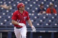 Washington Nationals' Ryan Zimmerman watches his solo home run during the third inning of a spring training baseball game against the Houston Astros Monday, March 1, 2021, in West Palm Beach, Fla. (AP Photo/Jeff Roberson)
