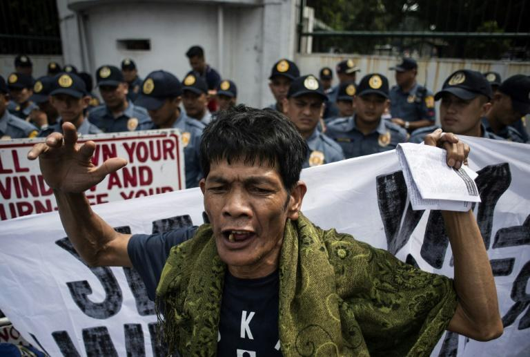 An activist shouts slogans during a protest against Philippine President Rodrigo Duterte in front of the Armed Forces of the Philippines (AFP) headquarters in Manila