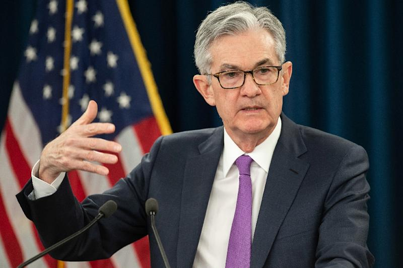 Committee members, led by Federal Reserve Board Chairman Jerome Powell (pictured January 2019), forecast a median federal funds rate for 2019 of 2.4 percent, down from the 2.9 percent forecast in December 2018 (AFP Photo/SAUL LOEB)