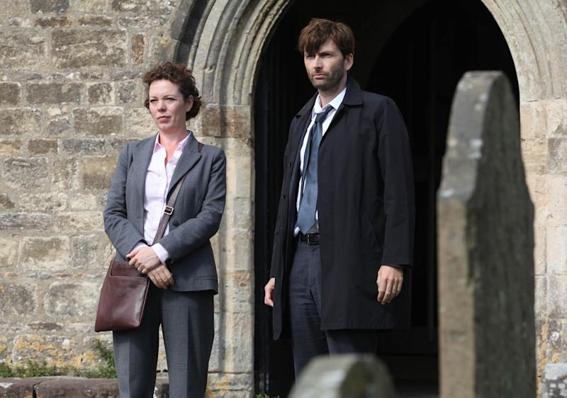"This publicity image released by BBC America shows David Tennant as Alec Hardy, right, and Olivia Coleman as Ellie Miller, from the series ""Broadchurch,"" premiering Aug. 7 at 10 p.m. EST. (AP Photo/BBC America, Patrick Redmond)"