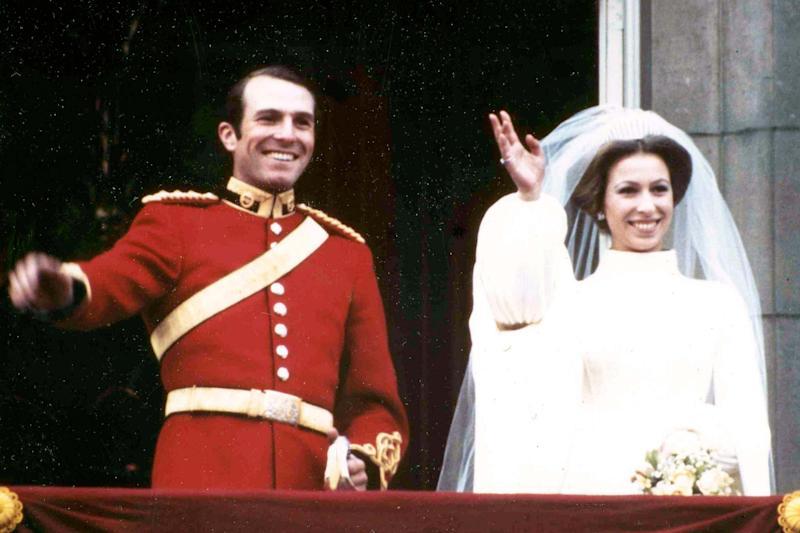Princess Anne and her husband Captain Mark Phillips wave from the balcony of Buckingham Palace (AP)
