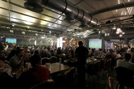 People watch the World Cup 2018 match between Egypt and Russia, at a cafe in Damascus, Syria June 19, 2018. Picture taken June 19, 2018. REUTERS/Omar Sanadiki
