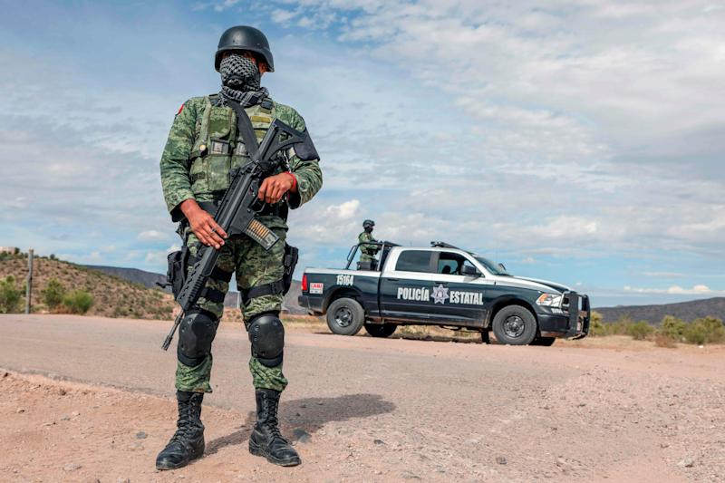 Members of the Mexican National Guard stand guard near La Morita ranch, belonging to the LeBaron family – of which nine members were shot to death Nov. 4 – in Bavispe, Sonora state, Mexico, on Nov. 6, 2019.