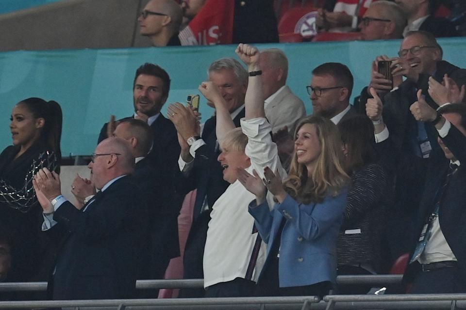 UK Prime Minister Boris Johnson (L) and his spouse Carrie (R) celebrate the second goal during the UEFA EURO 2020 semi-final football match between England and Denmark at Wembley Stadium in London on July 7, 2021. (Photo by Paul ELLIS / POOL / AFP) (Photo by PAUL ELLIS/POOL/AFP via Getty Images)