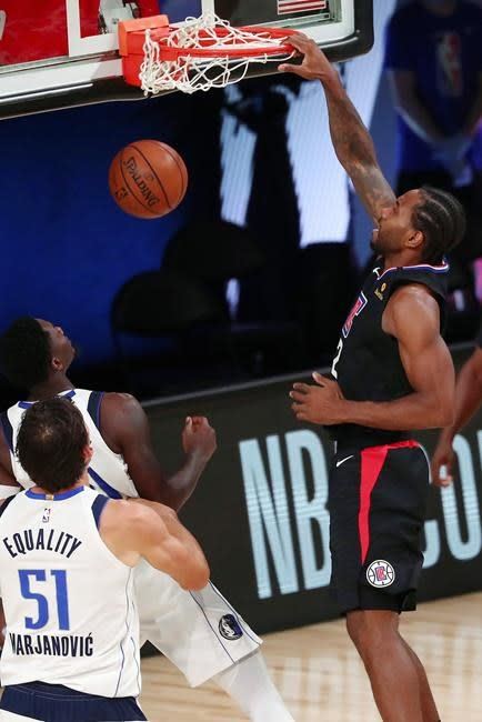 Mavs pull away while Doncic sits, beat Clippers 127-114