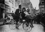 <p>This very stylish couple chose a festive and fun mode of transport to (or from?) their wedding — a bike! Note the floral decorations woven into the spokes, along with the very-French bridal ensemble. </p>